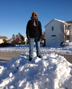 Tammy stands atop a huge pile of snow in our neighborhood after a December 2012 blizzard.